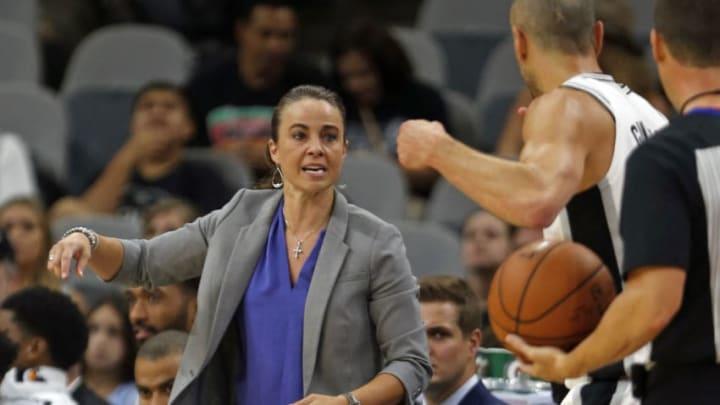 SAN ANTONIO,TX - OCTOBER 8: Filling in for head coach Gregg Popovich, Becky Hammon talks to Manu Ginobili