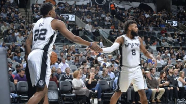 AN ANTONIO, TX – OCTOBER 10: Rudy Gay #22 and Patty Mills #8 of the San Antonio Spurs hife five during a preseason game against the Orlando Magic on October 10, 2017 at the AT&T Center in San Antonio, Texas. NOTE TO USER: User expressly acknowledges and agrees that, by downloading and or using this photograph, user is consenting to the terms and conditions of the Getty Images License Agreement. Mandatory Copyright Notice: Copyright 2017 NBAE (Photos by Mark Sobhani/NBAE via Getty Images)