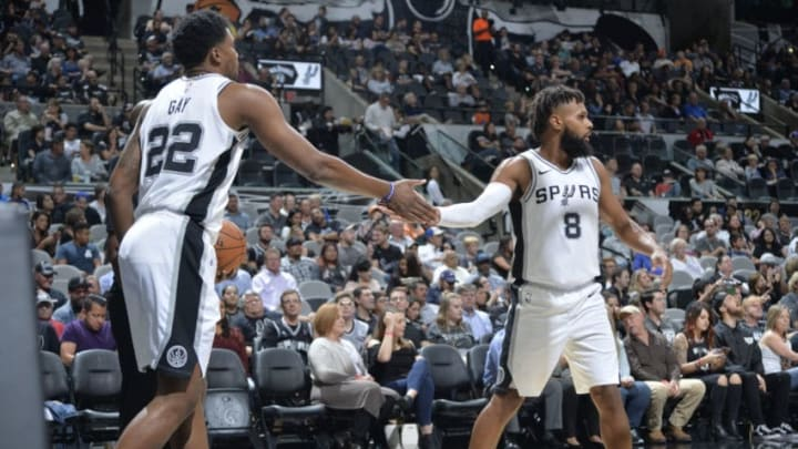 AN ANTONIO, TX - OCTOBER 10: Rudy Gay #22 and Patty Mills #8 of the San Antonio Spurs hife five during a preseason game against the Orlando Magic on October 10, 2017 at the AT&T Center in San Antonio, Texas. NOTE TO USER: User expressly acknowledges and agrees that, by downloading and or using this photograph, user is consenting to the terms and conditions of the Getty Images License Agreement. Mandatory Copyright Notice: Copyright 2017 NBAE (Photos by Mark Sobhani/NBAE via Getty Images)