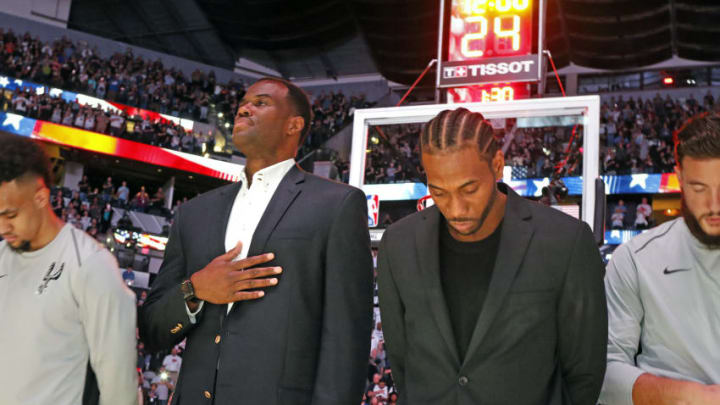 SAN ANTONIO,TX - OCTOBER 18: Former Spurs David Robinson joins injured Kawhi Leonard #2 of the San Antonio Spurs during the national anthem before the game against the Minnesota Timberwolves at AT&T Center on October 18, 2017 in San Antonio, Texas. NOTE TO USER: User expressly acknowledges and agrees that , by downloading and or using this photograph, User is consenting to the terms and conditions of the Getty Images License Agreement. (Photo by Ronald Cortes/Getty Images)