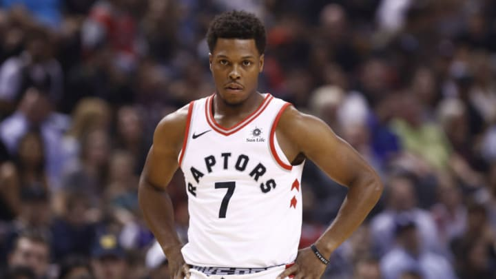 TORONTO, CANADA - OCTOBER 21: Kyle Lowry #7 of the Toronto Raptors looks on during the game against the Philadelphia 76ers on October 21, 2017 at the Air Canada Centre in Toronto, Ontario, Canada. NOTE TO USER: User expressly acknowledges and agrees that, by downloading and or using this Photograph, user is consenting to the terms and conditions of the Getty Images License Agreement. Mandatory Copyright Notice: Copyright 2017 NBAE (Photo by Mark Blinch/NBAE via Getty Images)