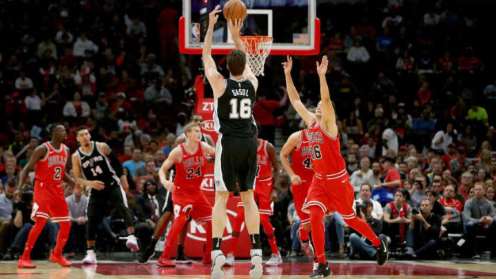 CHICAGO, IL - OCTOBER 21: Pau Gasol #16 of the San Antonio Spurs attempts a shot over Paul Zipser #16 of the Chicago Bulls in the first quarter at the United Center on October 21, 2017 in Chicago, Illinois. NOTE TO USER: User expressly acknowledges and agrees that, by downloading and or using this photograph, User is consenting to the terms and conditions of the Getty Images License Agreement. (Photo by Dylan Buell/Getty Images)