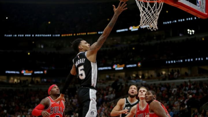 CHICAGO, IL - OCTOBER 21: Dejounte Murray #5 of the San Antonio Spurs attempts a shot in the fourth quarter against the Chicago Bulls at the United Center on October 21, 2017 in Chicago, Illinois. NOTE TO USER: User expressly acknowledges and agrees that, by downloading and or using this photograph, User is consenting to the terms and conditions of the Getty Images License Agreement. (Photo by Dylan Buell/Getty Images)