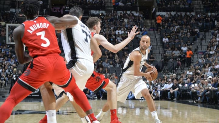 SAN ANTONIO, TX - OCTOBER 23: Manu Ginobili #20 of the San Antonio Spurs handles the ball against the Toronto Raptors on October 23, 2017 at the AT&T Center in San Antonio, Texas. NOTE TO USER: User expressly acknowledges and agrees that, by downloading and or using this photograph, user is consenting to the terms and conditions of the Getty Images License Agreement. Mandatory Copyright Notice: Copyright 2017 NBAE (Photos by Mark Sobhani/NBAE via Getty Images)