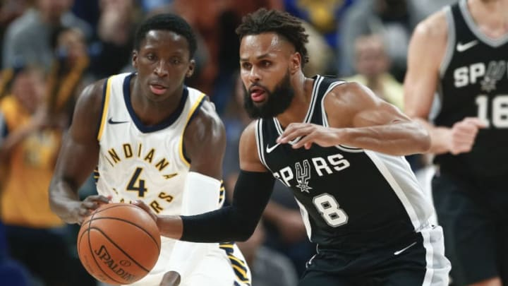 INDIANAPOLIS, IN - OCTOBER 29: Patty Mills #8 of the San Antonio Spurs brings the ball up court as Victor Oladipo #4 of the Indiana Pacers follows at Bankers Life Fieldhouse on October 29, 2017 in Indianapolis, Indiana. NOTE TO USER: User expressly acknowledges and agrees that, by downloading and or using this photograph, User is consenting to the terms and conditions of the Getty Images License Agreement.(Photo by Michael Hickey/Getty Images)