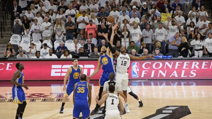 SAN ANTONIO, TX - MAY 22: JaVale McGee #1 of the Golden State Warriors and LaMarcus Aldridge #12 of the San Antonio Spurs go up for the opening tip opff Game Four of the Western Conference Finals during the 2017 NBA Playoffs on MAY 22, 2017 at the AT&T Center in San Antonio, Texas. NOTE TO USER: User expressly acknowledges and agrees that, by downloading and or using this photograph, user is consenting to the terms and conditions of the Getty Images License Agreement. Mandatory Copyright Notice: Copyright 2017 NBAE (Photos by David Dow/NBAE via Getty Images)