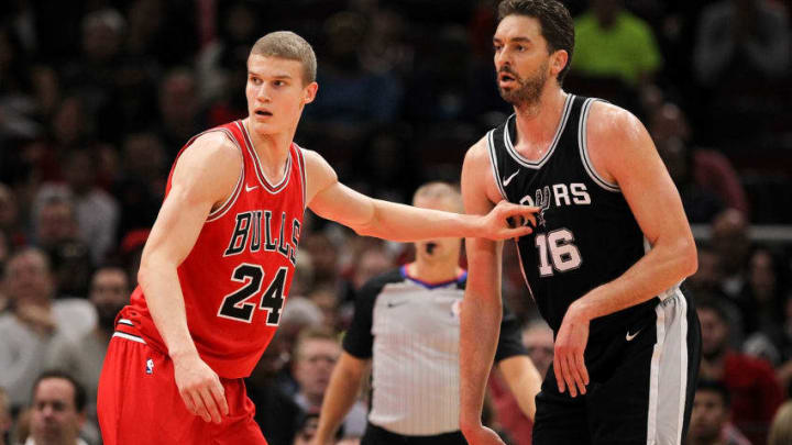 CHICAGO, IL - OCTOBER 21: Lauri Markkanen #24 of the Chicago Bulls guards against Pau Gasol #16 of the San Antonio Spurs in the first quarter at the United Center on October 21, 2017 in Chicago, Illinois. NOTE TO USER: User expressly acknowledges and agrees that, by downloading and or using this photograph, User is consenting to the terms and conditions of the Getty Images License Agreement. (Photo by Dylan Buell/Getty Images)