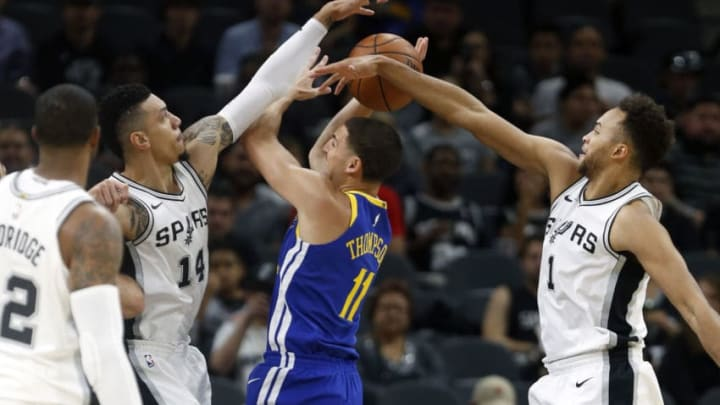 SAN ANTONIO,TX - NOVEMBER 2: Danny Green #14 of the San Antonio Spurs and Kyle Anderson #1 of the San Antonio Spurs com line to block the shot attempt of Klay Thompson #11 of the Golden State Warriors at AT&T Center on November 2, 2017 in San Antonio, Texas. NOTE TO USER: User expressly acknowledges and agrees that , by downloading and or using this photograph, User is consenting to the terms and conditions of the Getty Images License Agreement. (Photo by Ronald Cortes/Getty Images)