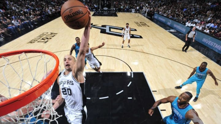 SAN ANTONIO, TX - NOVEMBER 3: Manu Ginobili #20 of the San Antonio Spurs dunks against the Charlotte Hornets on November 3, 2017 at the AT&T Center in San Antonio, Texas. NOTE TO USER: User expressly acknowledges and agrees that, by downloading and or using this photograph, user is consenting to the terms and conditions of the Getty Images License Agreement. Mandatory Copyright Notice: Copyright 2017 NBAE (Photos by Mark Sobhani/NBAE via Getty Images)