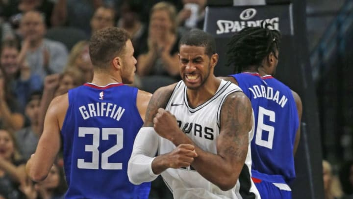 SAN ANTONIO,TX - NOVEMBER 7: LaMarcus Aldridge #12 of the San Antonio Spurs reacts after scoring a basket against the Los Angeles Clippers at AT&T Center on November 7, 2017 in San Antonio, Texas. NOTE TO USER: User expressly acknowledges and agrees that , by downloading and or using this photograph, User is consenting to the terms and conditions of the Getty Images License Agreement. (Photo by Ronald Cortes/Getty Images)