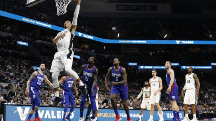 SAN ANTONIO,TX - NOVEMBER 7: Danny Green #14 of the San Antonio Spurs scores two against the Los Angeles Clippers at AT&T Center on November 7, 2017 in San Antonio, Texas. NOTE TO USER: User expressly acknowledges and agrees that , by downloading and or using this photograph, User is consenting to the terms and conditions of the Getty Images License Agreement. (Photo by Ronald Cortes/Getty Images)