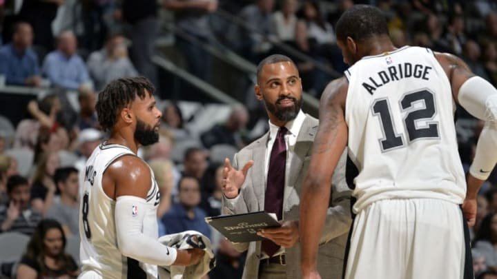 SAN ANTONIO, TX - NOVEMBER 7: LaMarcus Aldridge #12 and Patty Mills #8 talk to Assistant Coach Ime Udoka of the San Antonio Spurs during the game against the LA Clippers on November 7, 2017 at the AT&T Center in San Antonio, Texas. NOTE TO USER: User expressly acknowledges and agrees that, by downloading and or using this photograph, user is consenting to the terms and conditions of the Getty Images License Agreement. Mandatory Copyright Notice: Copyright 2017 NBAE (Photos by Mark Sobhani/NBAE via Getty Images)