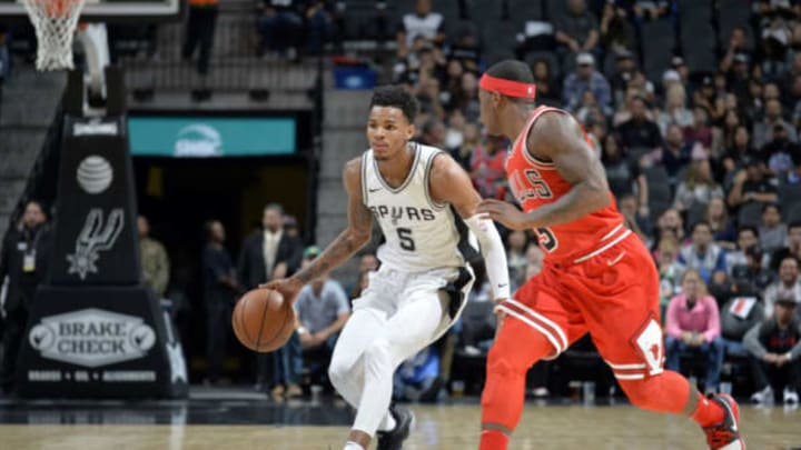 SAN ANTONIO, TX – NOVEMBER 11: Dejounte Murray #5 of the San Antonio Spurs handles the ball against the Chicago Bulls on November 11, 2017 at the AT&T Center in San Antonio, Texas. NOTE TO USER: User expressly acknowledges and agrees that, by downloading and or using this photograph, user is consenting to the terms and conditions of the Getty Images License Agreement. Mandatory Copyright Notice: Copyright 2017 NBAE (Photos by Mark Sobhani/NBAE via Getty Images)