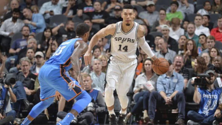 SAN ANTONIO, TX - NOVEMBER 17: Danny Green #14 of the San Antonio Spurs drives to the basket against the Oklahoma City Thunder on November 17, 2017 at the AT&T Center in San Antonio, Texas. NOTE TO USER: User expressly acknowledges and agrees that, by downloading and or using this photograph, user is consenting to the terms and conditions of the Getty Images License Agreement. Mandatory Copyright Notice: Copyright 2017 NBAE (Photos by Mark Sobhani/NBAE via Getty Images)