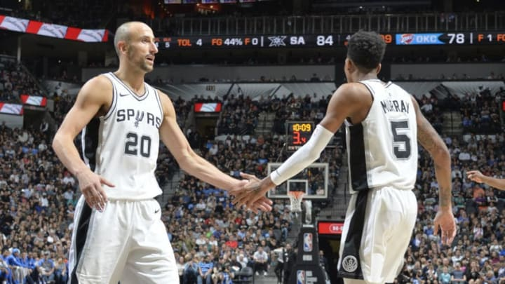 SAN ANTONIO, TX - NOVEMBER 17: Manu Ginobili #20 of the San Antonio Spurs celebrates with team mate Dejounte Murray #5 against the Oklahoma City Thunder on November 17, 2017 at the AT&T Center in San Antonio, Texas. NOTE TO USER: User expressly acknowledges and agrees that, by downloading and or using this photograph, user is consenting to the terms and conditions of the Getty Images License Agreement. Mandatory Copyright Notice: Copyright 2017 NBAE (Photos by Mark Sobhani/NBAE via Getty Images)