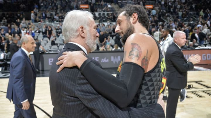 SAN ANTONIO, TX - NOVEMBER 20: Marco Belinelli #3 of the Atlanta Hawks after the game with Head Coach Gregg Popovich of the San Antonio Spurs on November 20, 2017 at the AT&T Center in San Antonio, Texas. NOTE TO USER: User expressly acknowledges and agrees that, by downloading and or using this photograph, user is consenting to the terms and conditions of the Getty Images License Agreement. Mandatory Copyright Notice: Copyright 2017 NBAE (Photos by Mark Sobhani/NBAE via Getty Images)