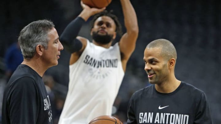 SAN ANTONIO,TX - NOVEMBER 27: Tony Parker #9 of the San Antonio Spurs talks with assistant coach Chip Engelland before the start of their game against the Dallas Mavericks at AT&T Center on November 27, 2017 in San Antonio, Texas. NOTE TO USER: User expressly acknowledges and agrees that , by downloading and or using this photograph, User is consenting to the terms and conditions of the Getty Images License Agreement. (Photo by Ronald Cortes/Getty Images)