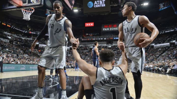 SAN ANTONIO, TX - NOVEMBER 27: Kyle Anderson #1 of the San Antonio Spurs is helped to his feet by his team as they play against the Dallas Mavericks on November 27, 2017 at the AT&T Center in San Antonio, Texas. NOTE TO USER: User expressly acknowledges and agrees that, by downloading and or using this photograph, user is consenting to the terms and conditions of the Getty Images License Agreement. Mandatory Copyright Notice: Copyright 2017 NBAE (Photos by Mark Sobhani/NBAE via Getty Images)