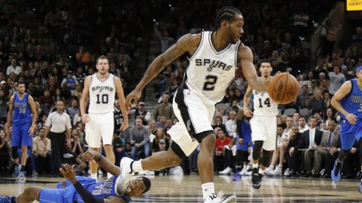 SAN ANTONIO,TX - NOVEMBER 21: Kawhi Leonard #2 of the San Antonio Spurs steals the ball from Harrison Barnes #40 of the Dallas Mavericks enroute to a dunk in closing minutes at AT&T Center on November 21, 2016 in San Antonio, Texas. NOTE TO USER: User expressly acknowledges and agrees that , by downloading and or using this photograph, User is consenting to the terms and conditions of the Getty Images License Agreement. (Photo by Ronald Cortes/Getty Images)
