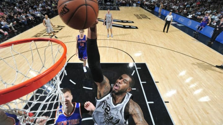 SAN ANTONIO, TX - MARCH 25: LaMarcus Aldridge #12 of the San Antonio Spurs dunks the ball during the game against the New York Knicks on March 25, 2017 at the AT&T Center in San Antonio, Texas. NOTE TO USER: User expressly acknowledges and agrees that, by downloading and or using this photograph, user is consenting to the terms and conditions of the Getty Images License Agreement. Mandatory Copyright Notice: Copyright 2017 NBAE (Photos by Mark Sobhani/NBAE via Getty Images)