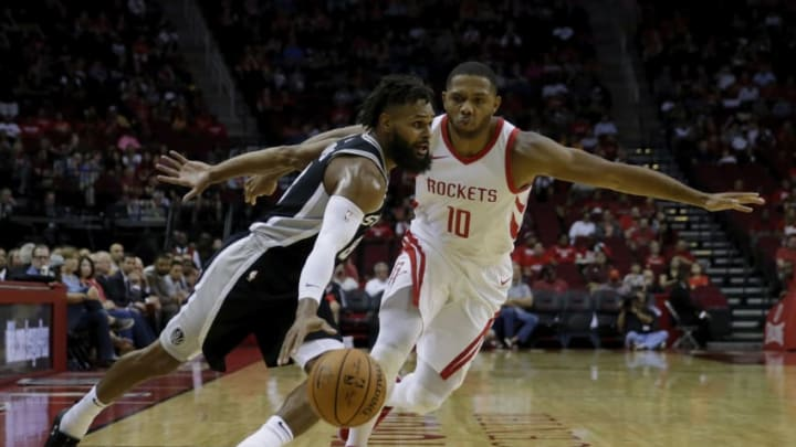 HOUSTON, TX - OCTOBER 13: Patty Mills #8 of the San Antonio Spurs drives to the basket defended by Eric Gordon #10 of the Houston Rockets in the first half at Toyota Center on October 13, 2017 in Houston, Texas. NOTE TO USER: User expressly acknowledges and agrees that, by downloading and or using this Photograph, user is consenting to the terms and conditions of the Getty Images License Agreement. (Photo by Tim Warner/Getty Images)