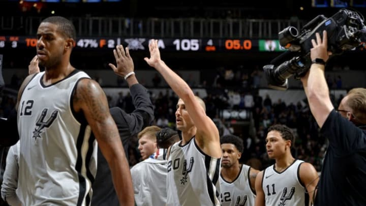 SAN ANTONIO, TX - DECEMBER 8: Manu Ginobili #20 of the San Antonio Spurs high fives his teammates after the game against the Boston Celtics on December 8, 2017 at the AT&T Center in San Antonio, Texas. NOTE TO USER: User expressly acknowledges and agrees that, by downloading and or using this photograph, user is consenting to the terms and conditions of the Getty Images License Agreement. Mandatory Copyright Notice: Copyright 2017 NBAE (Photos by Mark Sobhani/NBAE via Getty Images)