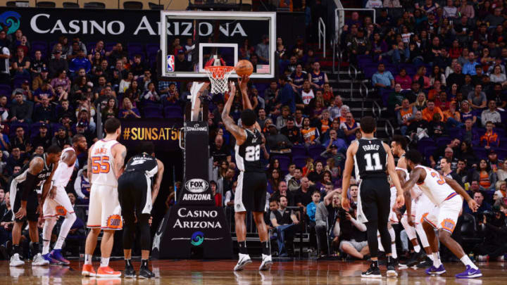 PHOENIX, AZ - DECEMBER 9: Rudy Gay #22 of the San Antonio Spurs shoots a free throw against the Phoenix Suns on December 9, 2017 at Talking Stick Resort Arena in Phoenix, Arizona. NOTE TO USER: User expressly acknowledges and agrees that, by downloading and or using this photograph, user is consenting to the terms and conditions of the Getty Images License Agreement. Mandatory Copyright Notice: Copyright 2017 NBAE (Photo by Michael Gonzales/NBAE via Getty Images)