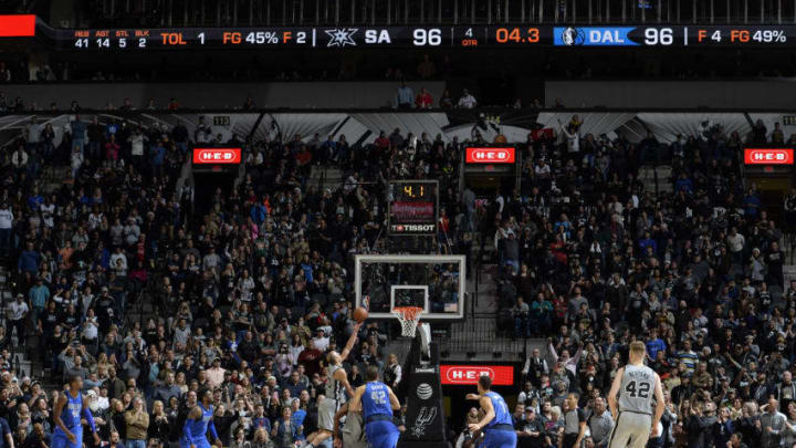 SAN ANTONIO, TX - DECEMBER 16: Manu Ginobili #20 of the San Antonio Spurs shoots the ball to win the game against the Dallas Mavericks on December 16, 2017 at the AT&T Center in San Antonio, Texas. NOTE TO USER: User expressly acknowledges and agrees that, by downloading and or using this photograph, user is consenting to the terms and conditions of the Getty Images License Agreement. Mandatory Copyright Notice: Copyright 2017 NBAE (Photos by Mark Sobhani/NBAE via Getty Images)