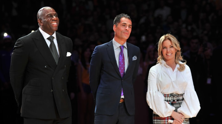 LOS ANGELES, CA – DECEMBER 18: (L-R) Magic Johnson, Rob Pelinka and Jeanie Buss attend Kobe Bryant's jersey retirement ceremony during a basketball game between the Los Angeles Lakers and the Golden State Warriors at Staples Center on December 18, 2017 in Los Angeles, California. (Photo by Allen Berezovsky/Getty Images)
