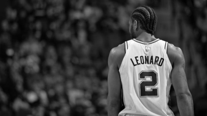SAN ANTONIO, TX - DECEMBER 18:(EDITORS NOTE: Image has been converted to black and white.) A shot of Kawhi Leonard #2 of the San Antonio Spurs during the game against the LA Clippers on December 18, 2017 at the AT&T Center in San Antonio, Texas. NOTE TO USER: User expressly acknowledges and agrees that, by downloading and or using this photograph, user is consenting to the terms and conditions of the Getty Images License Agreement. Mandatory Copyright Notice: Copyright 2017 NBAE (Photos by Mark Sobhani/NBAE via Getty Images)
