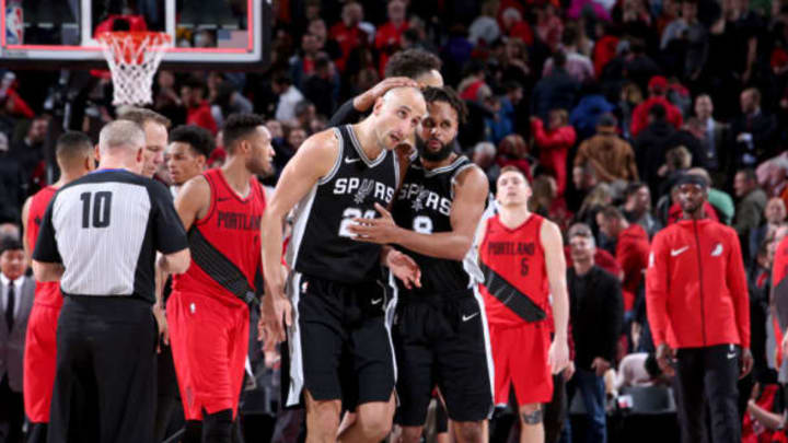 PORTLAND, OR – DECEMBER 20: Manu Ginobili #20 and Patty Mills #8 of the San Antonio Spurs hug after the game against the Portland Trail Blazers on December 20, 2017 at the Moda Center in Portland, Oregon. NOTE TO USER: User expressly acknowledges and agrees that, by downloading and or using this Photograph, user is consenting to the terms and conditions of the Getty Images License Agreement. Mandatory Copyright Notice: Copyright 2017 NBAE (Photo by Sam Forencich/NBAE via Getty Images)