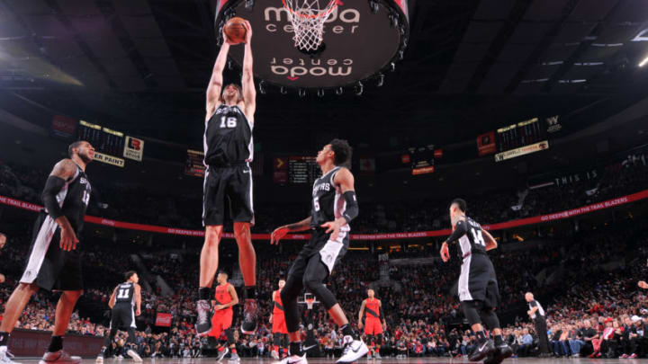 PORTLAND, OR - DECEMBER 20: Pau Gasol #16 of the San Antonio Spurs grabs the rebound against the Portland Trail Blazers on December 20, 2017 at the Moda Center in Portland, Oregon. NOTE TO USER: User expressly acknowledges and agrees that, by downloading and or using this Photograph, user is consenting to the terms and conditions of the Getty Images License Agreement. Mandatory Copyright Notice: Copyright 2017 NBAE (Photo by Sam Forencich/NBAE via Getty Images)