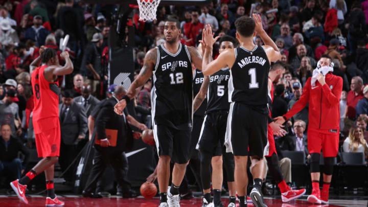 PORTLAND, OR - DECEMBER 20: LaMarcus Aldridge #12 exchanges high fives with Kyle Anderson #1 of the San Antonio Spurs during the game against the Portland Trail Blazers on December 20, 2017 at the Moda Center Arena in Portland, Oregon. NOTE TO USER: User expressly acknowledges and agrees that, by downloading and or using this photograph, user is consenting to the terms and conditions of the Getty Images License Agreement. Mandatory Copyright Notice: Copyright 2017 NBAE (Photo by Sam Forencich/NBAE via Getty Images)