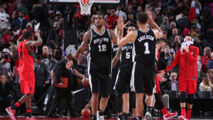 PORTLAND, OR – DECEMBER 20: LaMarcus Aldridge #12 exchanges high fives with Kyle Anderson #1 of the San Antonio Spurs during the game against the Portland Trail Blazers on December 20, 2017 at the Moda Center Arena in Portland, Oregon. NOTE TO USER: User expressly acknowledges and agrees that, by downloading and or using this photograph, user is consenting to the terms and conditions of the Getty Images License Agreement. Mandatory Copyright Notice: Copyright 2017 NBAE (Photo by Sam Forencich/NBAE via Getty Images)
