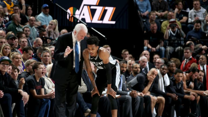 SALT LAKE CITY, UT - DECEMBER 21: Dejounte Murray #5 and Gregg Popovich of the San Antonio Spurs talk during the game against the Utah Jazz on DECEMBER 21, 2017 at vivint.SmartHome Arena in Salt Lake City, Utah. NOTE TO USER: User expressly acknowledges and agrees that, by downloading and or using this Photograph, User is consenting to the terms and conditions of the Getty Images License Agreement. Mandatory Copyright Notice: Copyright 2017 NBAE (Photo by Melissa Majchrzak/NBAE via Getty Images)