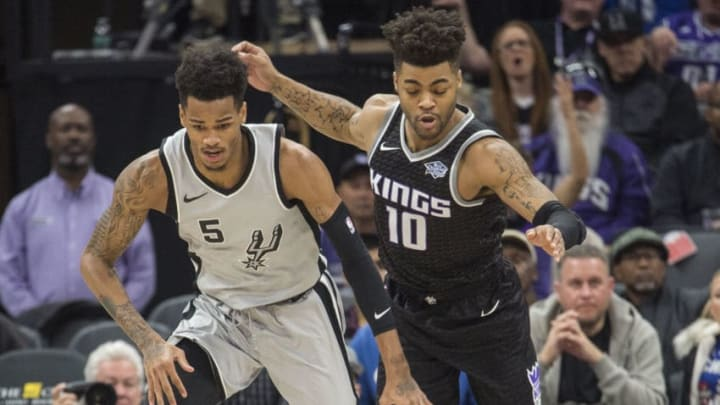 The San Antonio Spurs' Dejounte Murray (5) chases the ball after he blocked a shot by the Sacramento Kings' Kosta Koufos, not pictured, as the Kings' Frank Mason III (10) trails the play on Saturday, Dec. 23, 2017, at Golden 1 Center in Sacramento, Calif. (Hector Amezcua/Sacramento Bee/TNS via Getty Images)