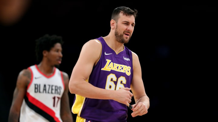 LOS ANGELES, CA – DECEMBER 23: Andrew Bogut #66 of the Los Angeles Lakers reacts to fouling out as Ed Davis #17 of the Portland Trail Blazers looks on during the second half of a game at Staples Center on December 23, 2017 in Los Angeles, California. NOTE TO USER: User expressly acknowledges and agrees that, by downloading and or using this photograph, User is consenting to the terms and conditions of the Getty Images License Agreement. (Photo by Sean M. Haffey/Getty Images)
