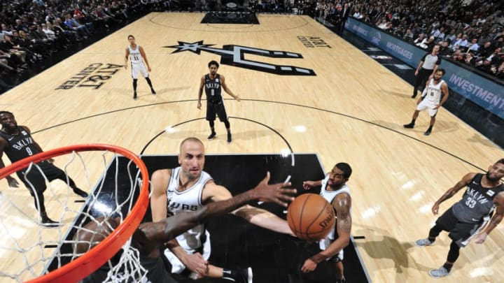 SAN ANTONIO, TX - DECEMBER 26: Manu Ginobili #20 of the San Antonio Spurs handles the ball against the Brooklyn Nets on December 26, 2017 at the AT&T Center in San Antonio, Texas. NOTE TO USER: User expressly acknowledges and agrees that, by downloading and or using this photograph, user is consenting to the terms and conditions of the Getty Images License Agreement. Mandatory Copyright Notice: Copyright 2017 NBAE (Photos by Mark Sobhani/NBAE via Getty Images)