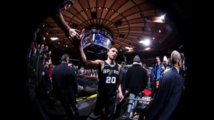 NEW YORK, NY - JANUARY 2: Manu Ginobili #20 of the San Antonio Spurs high fives as a fan as he exits the arena after the game against the New York Knicks on January 2, 2018 at Madison Square Garden in New York, New York. NOTE TO USER: User expressly acknowledges and agrees that, by downloading and or using this Photograph, user is consenting to the terms and conditions of the Getty Images License Agreement. Mandatory Copyright Notice: Copyright 2018 NBAE (Photo by Nathaniel S. Butler/NBAE via Getty Images)