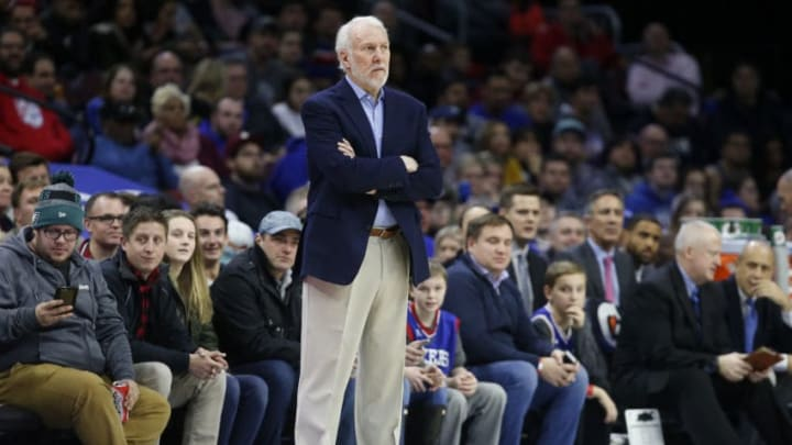PHILADELPHIA, PA - JANUARY 3: Head coach Gregg Popovich of the San Antonio Spurs follows the game against the Philadelphia 76ers in the first half at Wells Fargo Center on January 3, 2018 in Philadelphia, Pennsylvania. NOTE TO USER: User expressly acknowledges and agrees that, by downloading and or using this photograph, User is consenting to the terms and conditions of the Getty Images License Agreement. (Photo by Rob Carr/Getty Images)