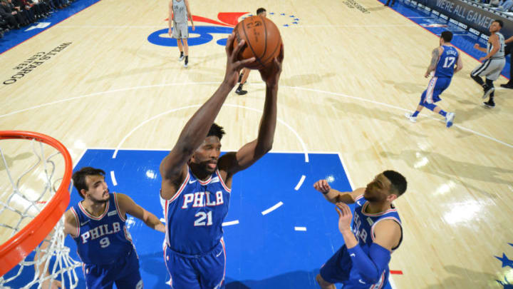 PHILADELPHIA,PA - JANUARY 3 : Joel Embiid #21 of the Philadelphia 76ers grabs the rebound against the San Antonio Spurs at Wells Fargo Center on January 3, 2018 in Philadelphia, Pennsylvania NOTE TO USER: User expressly acknowledges and agrees that, by downloading and/or using this Photograph, user is consenting to the terms and conditions of the Getty Images License Agreement. Mandatory Copyright Notice: Copyright 2018 NBAE (Photo by Jesse D. Garrabrant/NBAE via Getty Images)