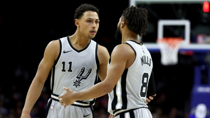 PHILADELPHIA, PA - JANUARY 3: Bryn Forbes #11 and Patty Mills #8 of the San Antonio Spurs talk against the Philadelphia 76ers at Wells Fargo Center on January 3, 2018 in Philadelphia, Pennsylvania. NOTE TO USER: User expressly acknowledges and agrees that, by downloading and or using this photograph, User is consenting to the terms and conditions of the Getty Images License Agreement. (Photo by Rob Carr/Getty Images)