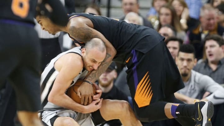 SAN ANTONIO,TX - JANUARY 05 : Manu Ginobili #20 of the San Antonio Spurs tries to steal the ball from Marquese Chriss #0 of the Phoenix Suns but is instead called for a foul at AT&T Center on January 05, 2018 in San Antonio, Texas. NOTE TO USER: User expressly acknowledges and agrees that , by downloading and or using this photograph, User is consenting to the terms and conditions of the Getty Images License Agreement. (Photo by Ronald Cortes/Getty Images)