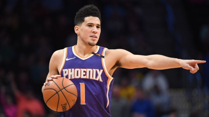 DENVER, CO - JANUARY 03: Devin Booker #1 of the Phoenix Suns sets the play against the Denver Nuggets at Pepsi Center on January 3, 2018 in Denver, Colorado. NOTE TO USER: User expressly acknowledges and agrees that, by downloading and or using this photograph, User is consenting to the terms and conditions of the Getty Images License Agreement. (Photo by Justin Tafoya/Getty Images)