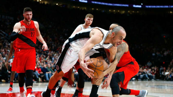 PORTLAND, OR - JANUARY 07: Manu Ginobli #20 of the San Antonio Spurs looks to pass the ball against the Portland Trail Blazers Moda Center on January 7, 2018 in Portland, Oregon.OTE TO USER: User expressly acknowledges and agrees that, by downloading and or using this photograph, User is consenting to the terms and conditions of the Getty Images License Agreement. (Photo by Jonathan Ferrey/Getty Images)