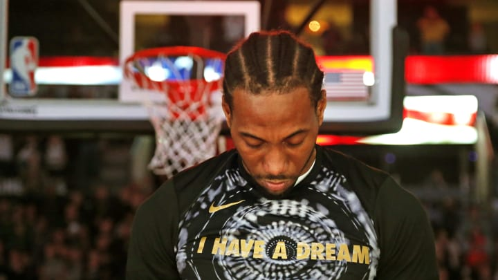 SAN ANTONIO,TX – JANUARY 13 : Kawhi Leonard #2 of the San Antonio Spurs bows his head during the playing of the National Anthem before the start of his game against the Denver Nuggets at AT&T Center on January 13, 2018 in San Antonio, Texas. NOTE TO USER: User expressly acknowledges and agrees that , by downloading and or using this photograph, User is consenting to the terms and conditions of the Getty Images License Agreement. (Photo by Ronald Cortes/Getty Images)