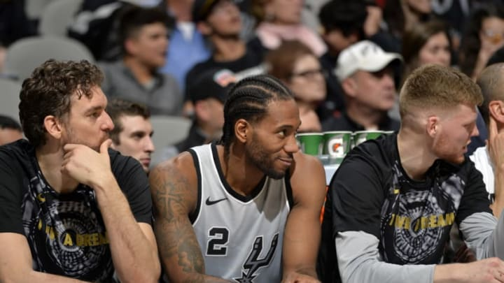 SAN ANTONIO, TX - JANUARY 13: Pau Gasol #16 of the San Antonio Spurs, Kawhi Leonard #2 of the San Antonio Spurs, and Davis Bertans #42 of the San Antonio Spurs look on against the Denver Nuggets on January 13, 2018 at the AT&T Center in San Antonio, Texas. NOTE TO USER: User expressly acknowledges and agrees that, by downloading and or using this photograph, user is consenting to the terms and conditions of the Getty Images License Agreement. Mandatory Copyright Notice: Copyright 2018 NBAE (Photos by Mark Sobhani/NBAE via Getty Images)