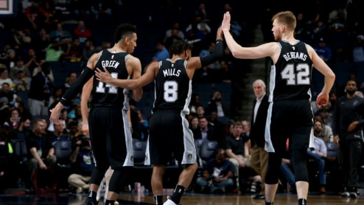MEMPHIS, TN - JANUARY 24: Danny Green #14, Patty Mills #8, and Davis Bertans #42 of the San Antonio Spurs high five during the game against the Memphis Grizzlies on January 24, 2018 at FedExForum in Memphis, Tennessee. NOTE TO USER: User expressly acknowledges and agrees that, by downloading and or using this photograph, User is consenting to the terms and conditions of the Getty Images License Agreement. Mandatory Copyright Notice: Copyright 2018 NBAE (Photo by Joe Murphy/NBAE via Getty Images)