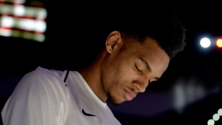SAN ANTONIO, TX - JANUARY 26: Dejounte Murray #5 of the San Antonio Spurs honors the National Anthem before the game against the Philadelphia 76ers on January 26, 2018 at the AT&T Center in San Antonio, Texas. NOTE TO USER: User expressly acknowledges and agrees that, by downloading and or using this photograph, user is consenting to the terms and conditions of the Getty Images License Agreement. Mandatory Copyright Notice: Copyright 2018 NBAE (Photos by Mark Sobhani/NBAE via Getty Images)