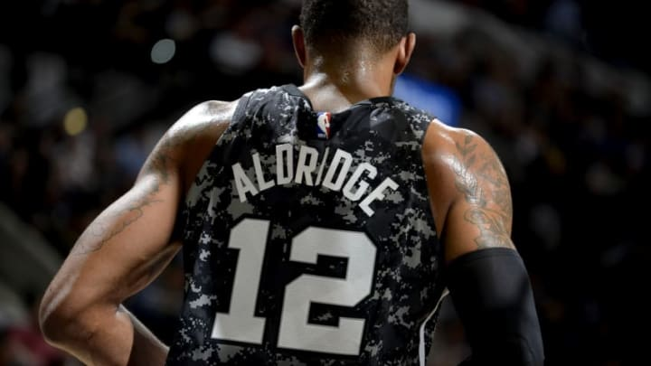 SAN ANTONIO, TX - JANUARY 26: LaMarcus Aldridge #12 of the San Antonio Spurs looks on during the game against the Philadelphia 76ers on January 26, 2018 at the AT&T Center in San Antonio, Texas. NOTE TO USER: User expressly acknowledges and agrees that, by downloading and or using this photograph, user is consenting to the terms and conditions of the Getty Images License Agreement. Mandatory Copyright Notice: Copyright 2018 NBAE (Photos by Mark Sobhani/NBAE via Getty Images)